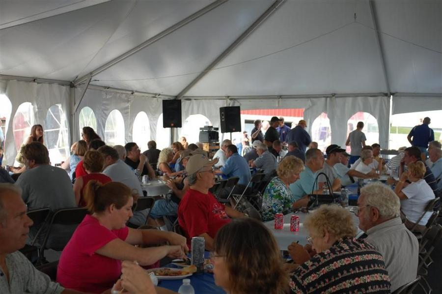 Attendees enjoy a feast of barbecued chicken, steak, pork, turkey and all the fixins'.