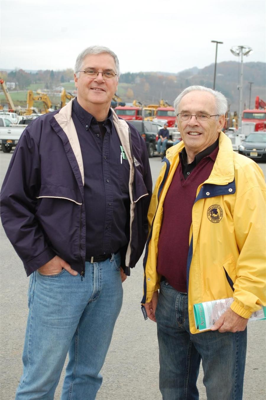 Gerard Calamari (L), president of Contractors Sales in Albany, N.Y,. and Murf Murphy, president of Best Tractor in Syracuse, N.Y., discuss trends in the used equipment market.