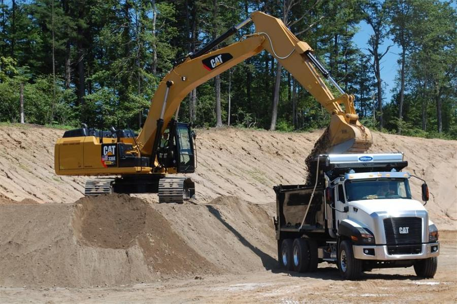 The new Caterpillar 336E excavator works in tandem with a Caterpillar CT660 dump truck.