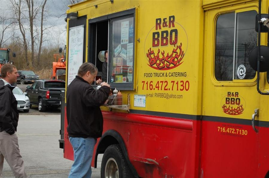 Attendees enjoy a delicious barbecue lunch provided by R & R Barbecue.