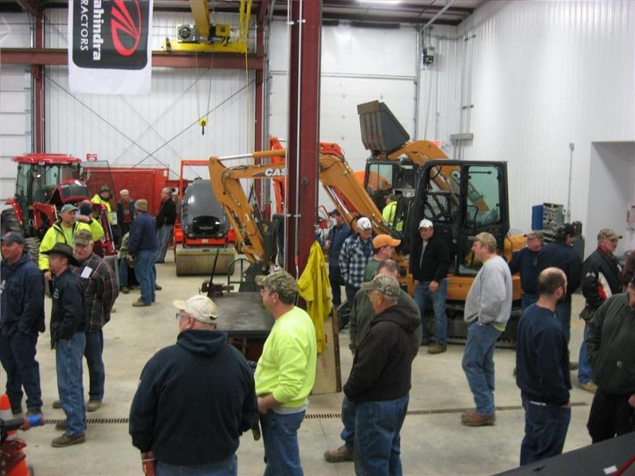 Contractors and farmers from across the Southern Tier of New York gather to inspect the new shop facilities at Monroe Tractor's Binghamton, N.Y., location.