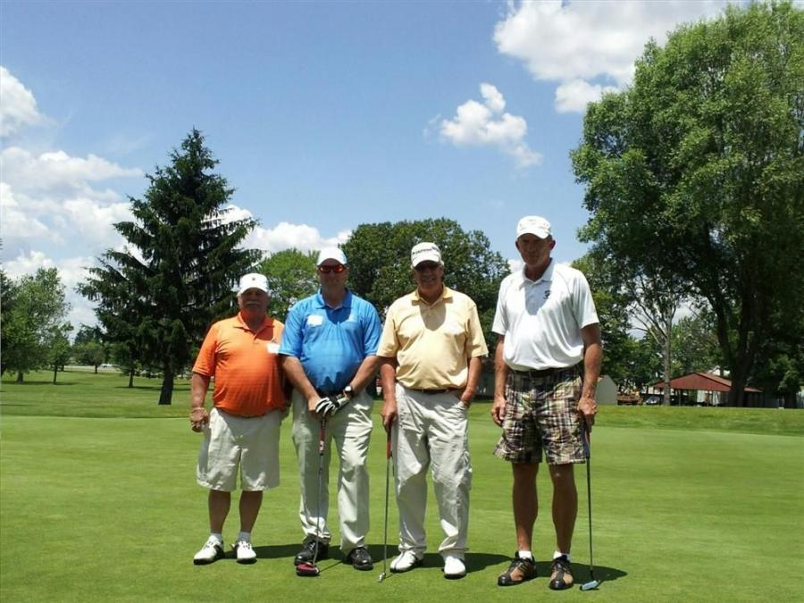 The 1st place team. (L-R) are Harry Brady of C, H & D Enterprises Inc., Art Golembiewski of Walsh Construction, Tom Udland of Murphy Tractor & Equipment Co. Inc., and Jay Noel of NPK.