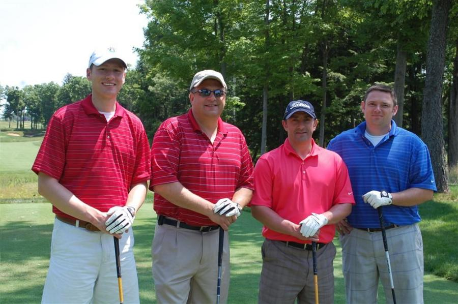 Preparing to tee off on the stunning first hole of the Shenandoah golf course, (L-R) are Tim Torry, Enterprise Fleet Management; Jeff Rogers, Mueller Farms Landscape Company; Martin Smith, The Pipe Company; and James Barren, Enterprise Fleet Management.