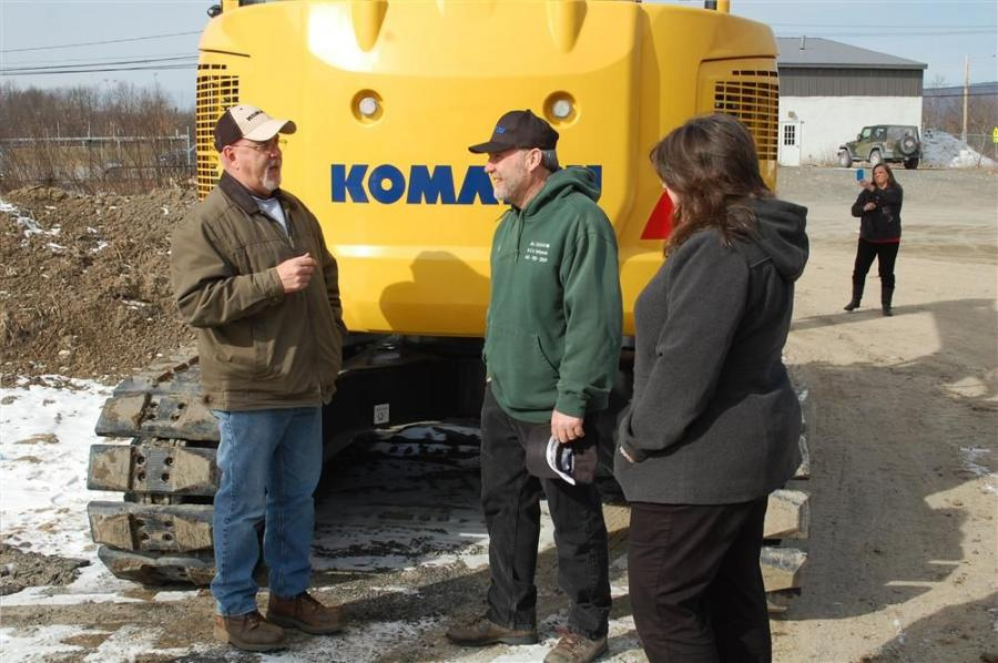 (L-R): Charlie Nash, warranty manager of Pine Bush Equipment, discusses the 2-year Komatsu warranty with Mike DeVenuto of J.A.L. Excavating Inc. and Karie Boniface of Pine Bush Equipment.
