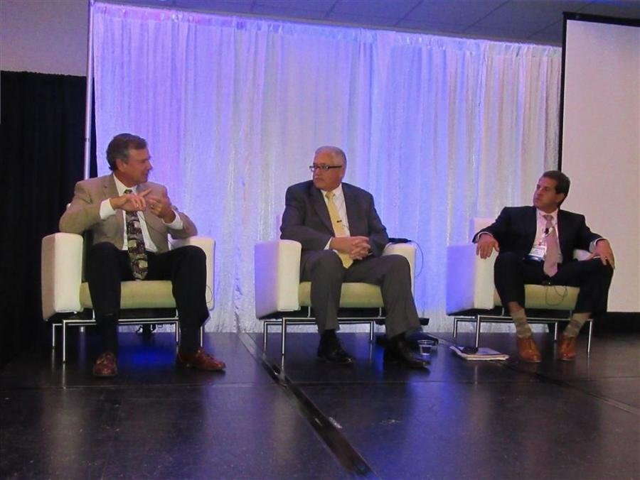 (L-R): Joe Frantz of Range Resources, Craig Neal of CNX Gas Company and Ken Mariani of EnerVest participate in a panel discussion on the state of the oil and gas industry.