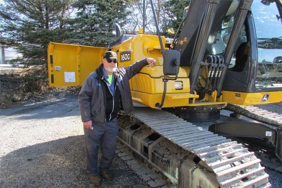 Ken Ritter of the borough of Coopersburg, Pa., checks out this John Deere 160Glc excavator.