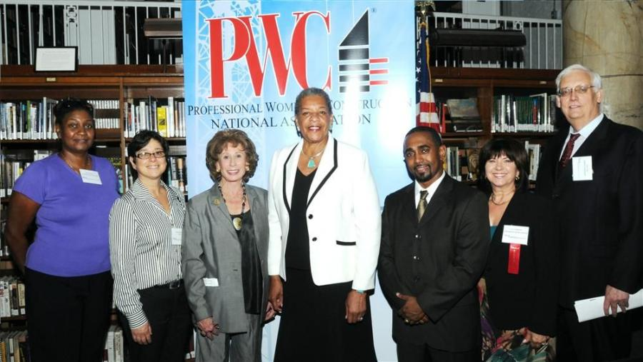 (L-R) are Flora Ramos, Tishman Construction Corp.; Andis Woodlief, CxA Services; Lenore Janis, PWC; NYS Senator Ruth Hassell-Thompson; Carl Peters, PANYNJ; Lina Gottesman, Altus Metal & Marble; and Larry Turk, SOMAQ International.