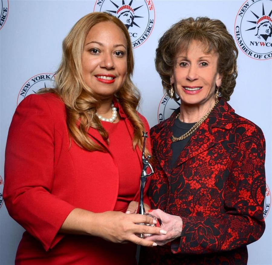 Photo Courtesy of John Caballero. New York Women's Chamber of Commerce President Quenia Abreu presents Women of Excellence award to Professional Women in Construction President Lenore Janis.