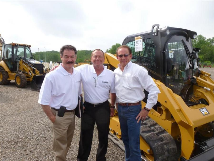 (L-R): Marty Lindmeier and Wayne Martin, both of Ransome CAT, and Michael Bartsch of B & J Excavating Inc., Downingtown, Pa., meet up at the one-day sale.