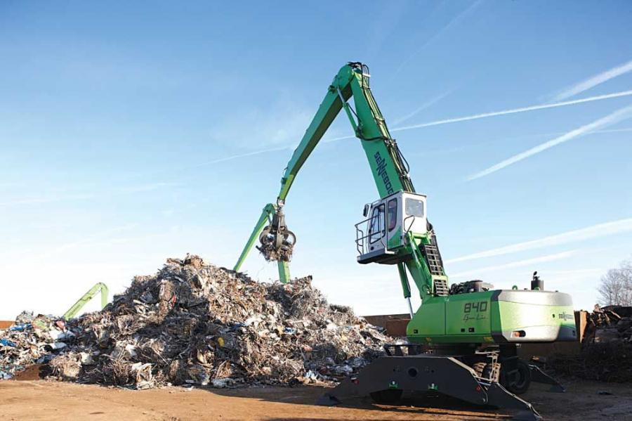 A new 840 D Series with a hydraulic cab featuring a sliding door and external walkway works the pile.