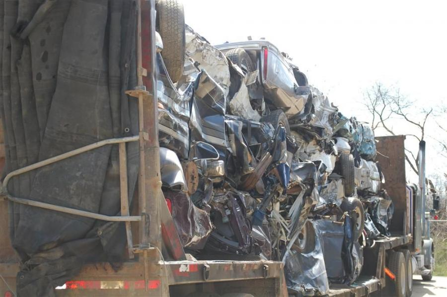 A truckload of crushed cars waits to be unloaded at the Owego, N.Y., facility of Upstate Shredding.