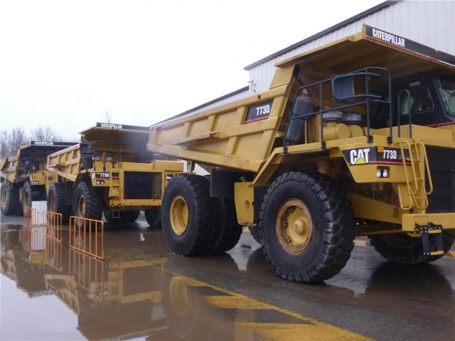 Caterpillar 773Ds and a 777D off-highway truck roll over the auction ramp on North East, Md.