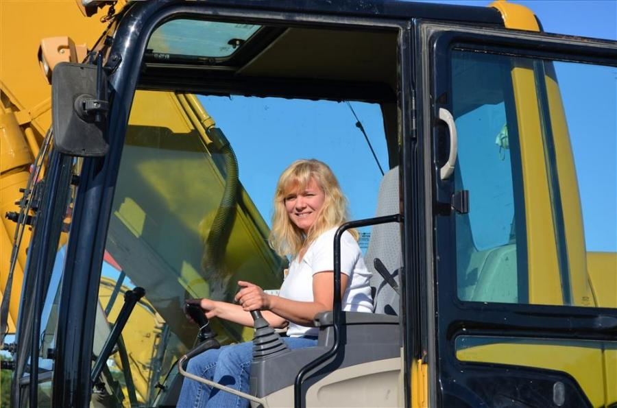 Lori Gurley of Bejeski Construction Inc., Avoca, Pa., enjoyed the beautiful weather and the great selection of equipment at the Ritchie Bros. auction.