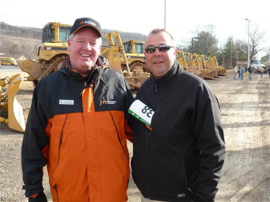 Ritchie Bros. Vice President of Sales Joe Boyle (L) and Bill Yurkovic, corporate used equipment manager, Cleveland Brothers, Harrisburg, Pa., meet up at the auction in Williamsport, Pa.