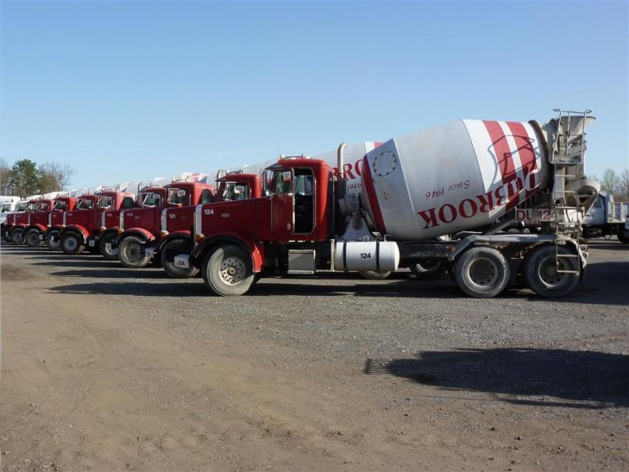 Peterbilt tandem axle ready-mix trucks equipped with 10 cu. yd. (7.6 cu m) London barrels ready for the auction ramp.