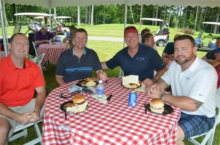 Enjoying a delicious barbecue lunch at the turn (L-R) are Mike Riccelli of Riccelli Enterprises; Richard Riccelli of Riccelli Enterprises; Scott Collins of Tracey Road Equipment; and Brian Shanahan of Sevenson Environmental.