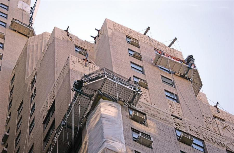 Skyline Restoration's work for the New Yorker building is a multi-phase project that includes terra cotta parapet restoration, roofing and terrace replacement and Local Law 11/98 repairs.