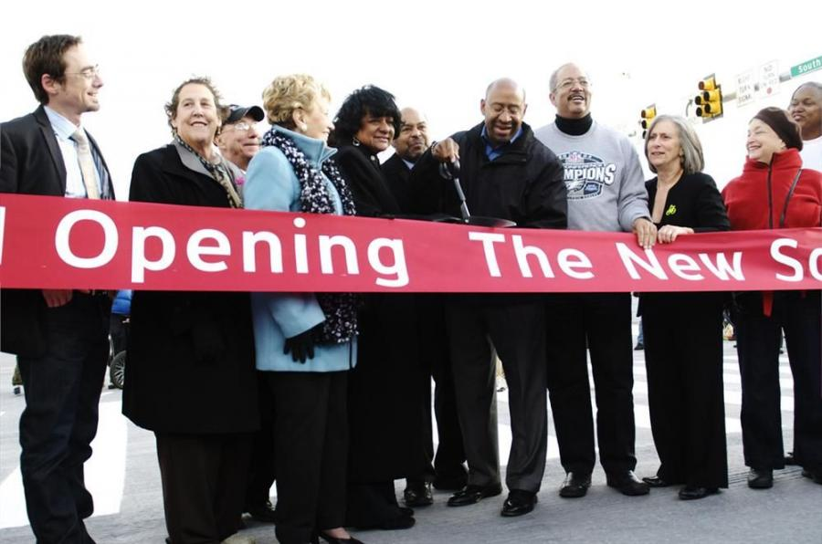 (Copyright city of Philadelphia. Photograph by Kaitlin Privitera.) Mayor Michael A. Nutter (fifth from R) and other elected officials and community leaders open the new South Street Bridge, a $67 million project completed early and on-budget.