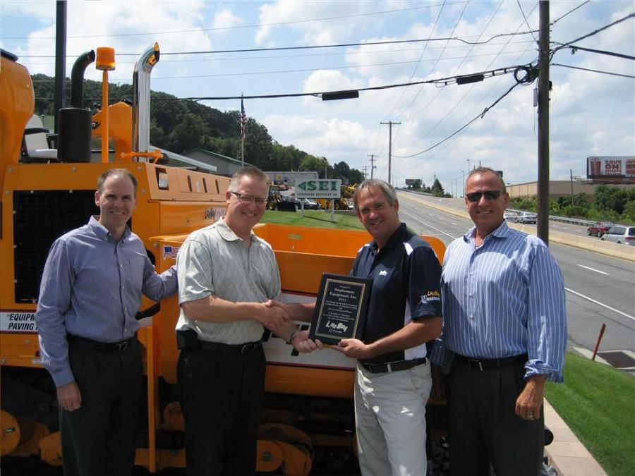 (L-R) are Bob Criste, executive vice president and CFO of SEI, Mark Myers, sales manager of SEI, Jim Harkins, territory manager of VT LeeBoy and Dennis Heller, president and CEO of SEI.