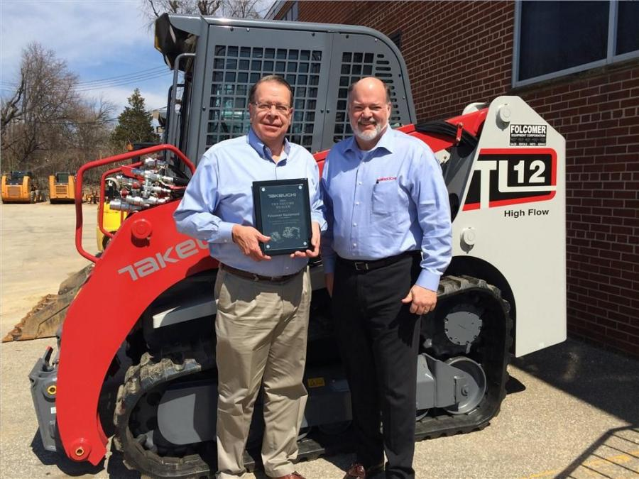 Folcomer President Dave Folcomer received Takeuchi's 2014 Top Volume Dealer of the Year award from Takeuchi-US President Clay Eubanks.