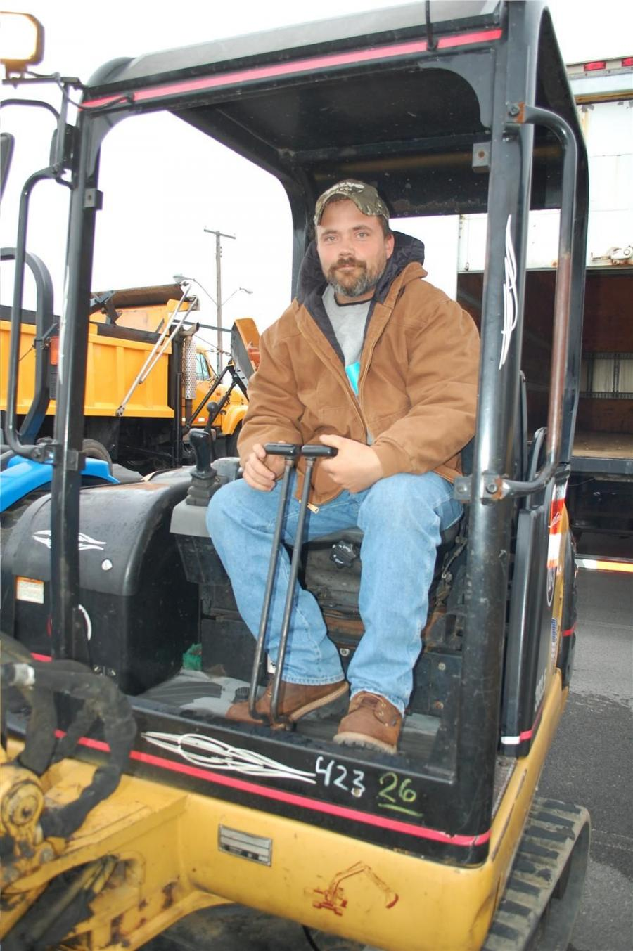 Al Smith of Wood Stone & Earth Construction, Palmyra, N.Y., has his eye on this Caterpillar 303.5 compact excavator.