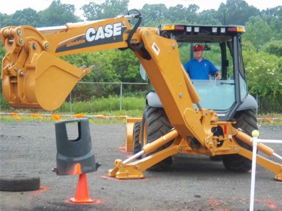 Tim Kelly of Scheidler Excavating, Hightstown, N.J., places the trash can over the cone in the backhoe event.