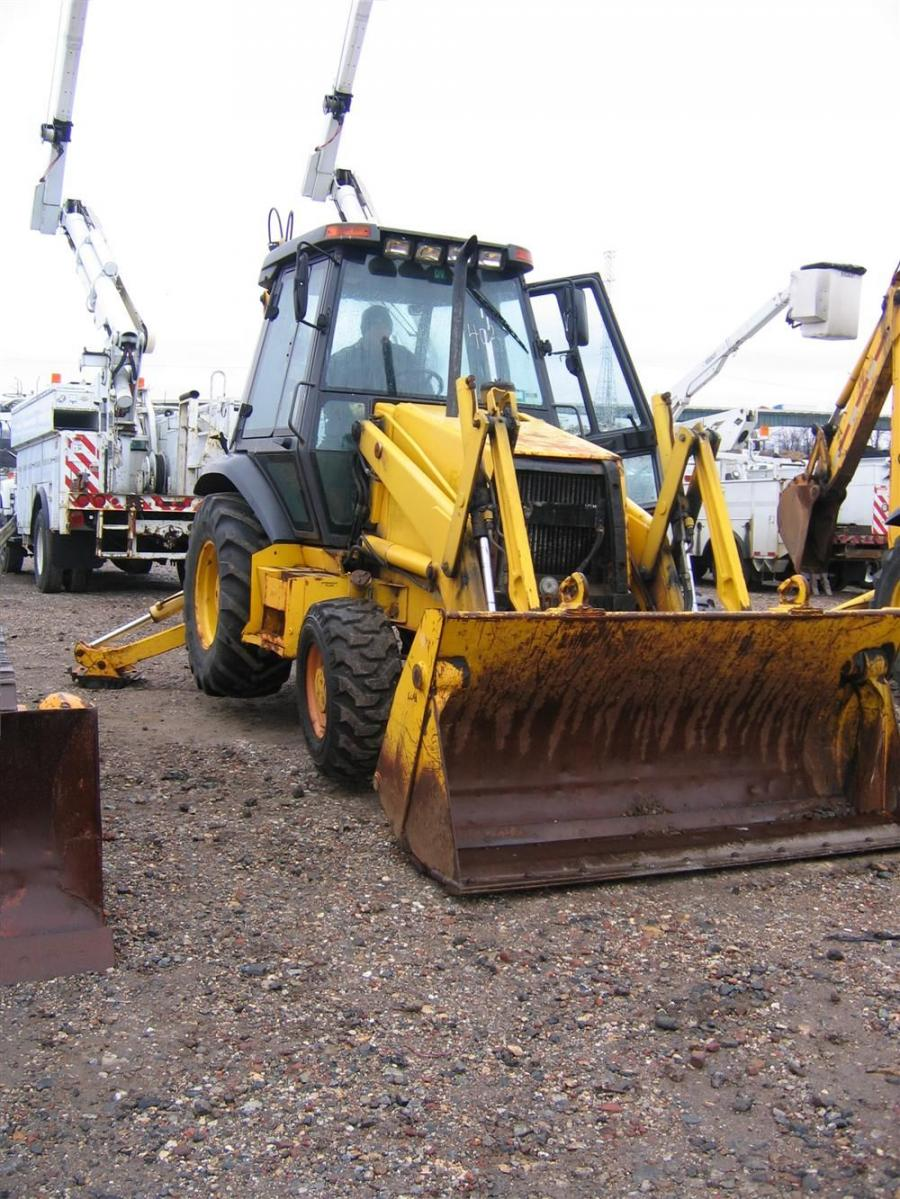 A prospective bidder starts up this Case backhoe prior to the auction truck's arrival.