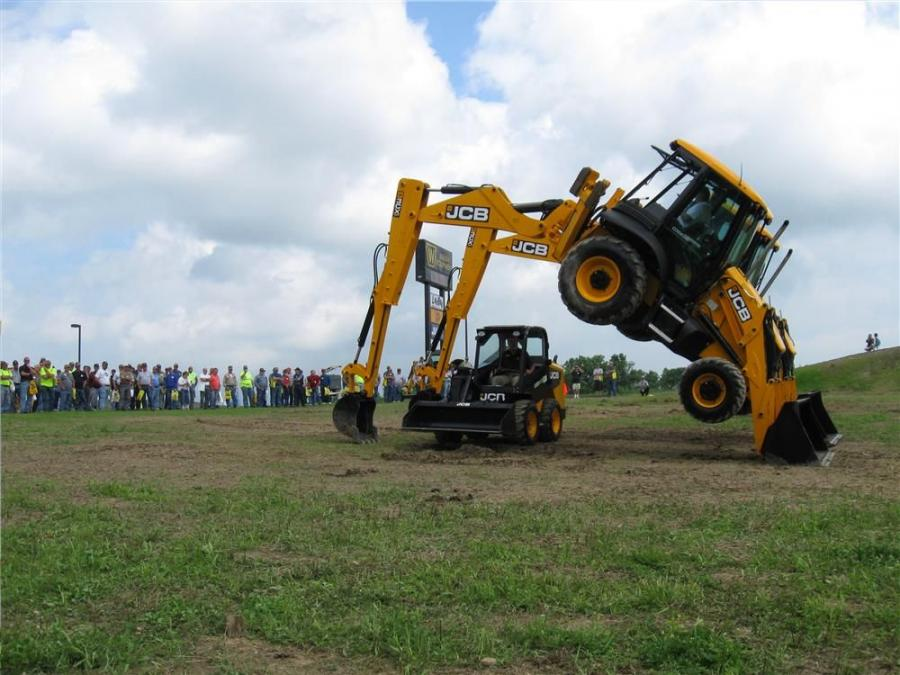 An appreciative crowd watches a performance by JCB's Dancing Diggers.