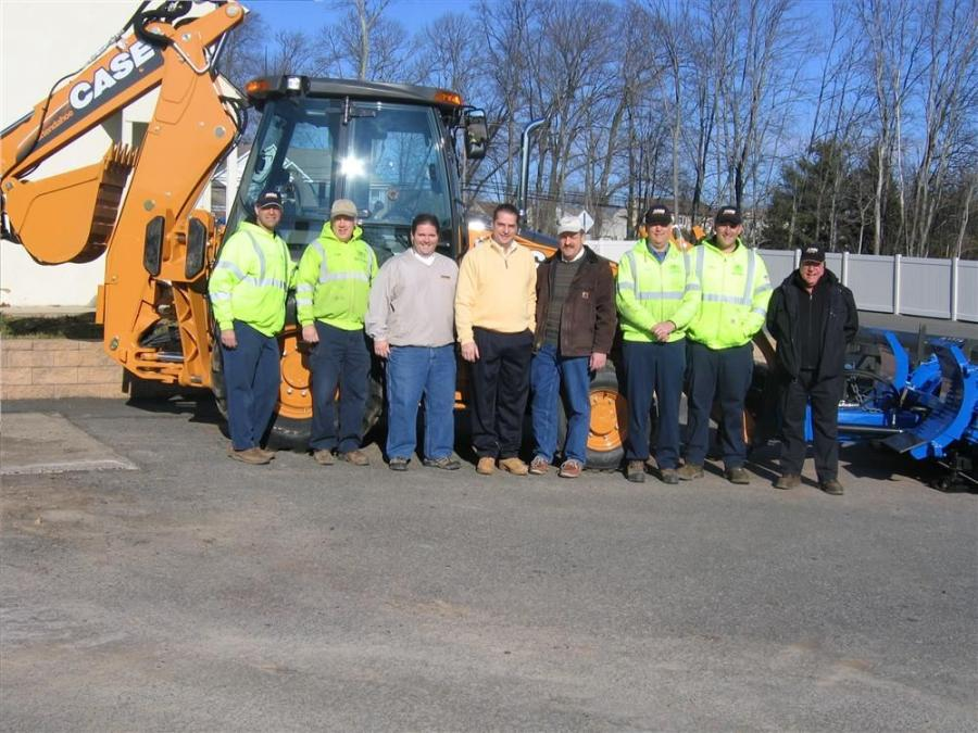 Standing by Warwick Township's new Case 580 backhoe (L-R) are Paul Schneider, crewmember, and Ted Rickner, senior crewmember, both of Warwick Township's public works department; Jim Lutz, sales representative of Eagle Power & Equipment; Lorenz