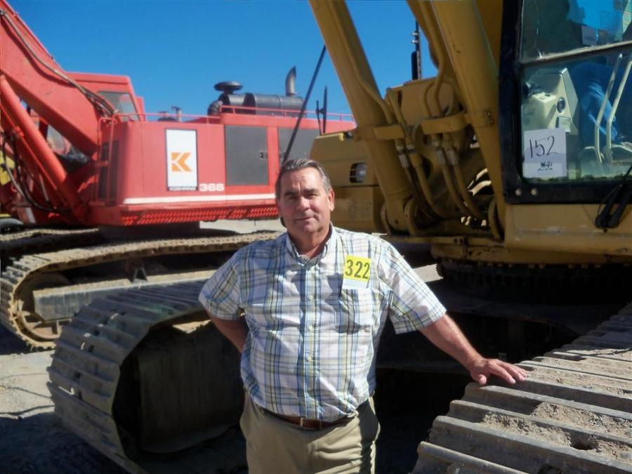 Paul Sill, president of Frederick Concrete, Frederick, Md., stands ready to bid on this excavator.