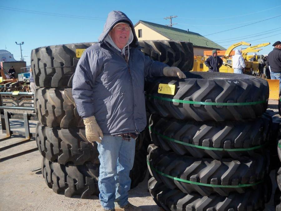 Jack Slimmer, independent contractor of Myersville, Md., looks to take home a few tires.