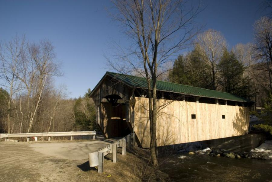 A covered bridge near Stowe, Vt. A recent report indicated that Vermont should look at building longer bridges with their supports farther from the edges of rivers to accommodate flood waters.