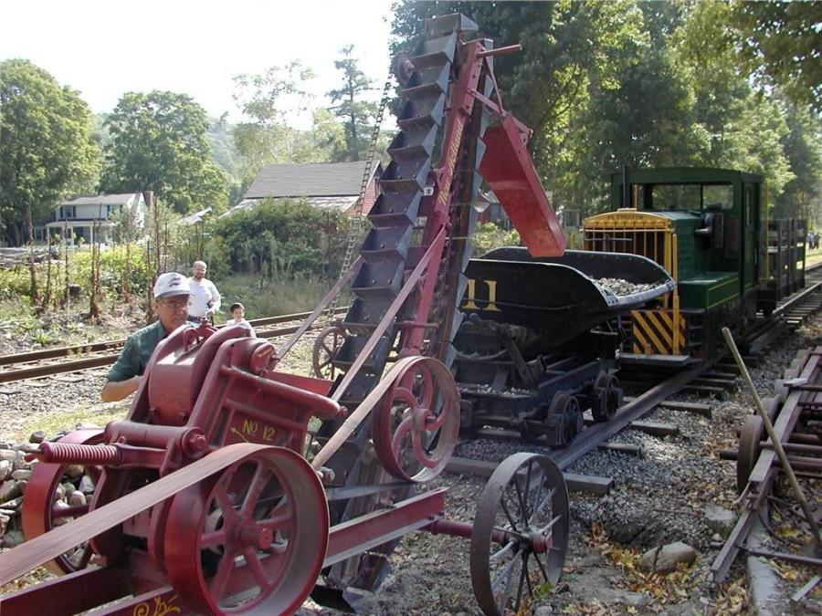 A New Holland rock crusher being demonstrated at a Fall Festival.