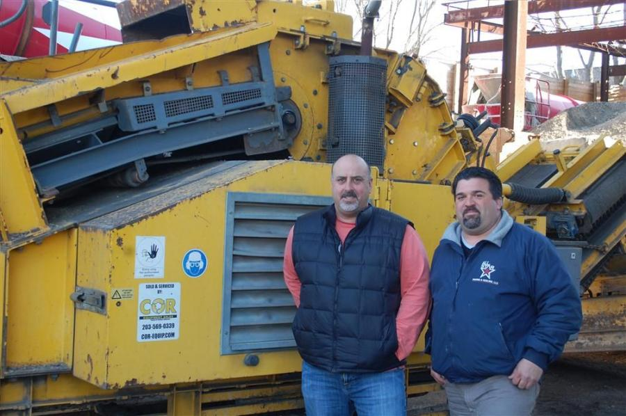 T.J. Koester (R) has found great success with the Rubble Master recycler his company bought from D.J. Cavaliere and COR Equipment.