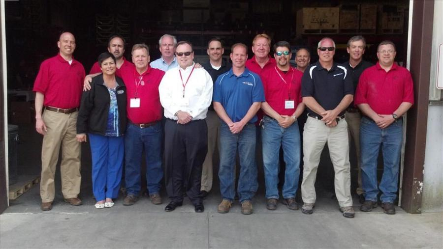 Employees and vendors line up for the EESSCO customer appreciation day.