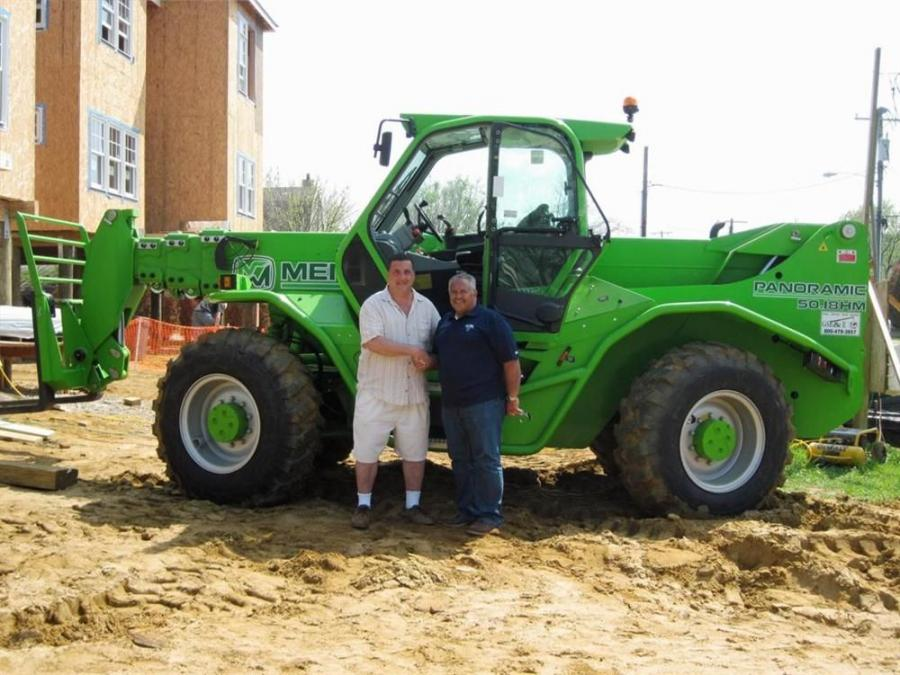 Vince DeRienzo (L), regional sales manager of GSE&E, and Charles Farkouh, Home & Land Development CEO, celebrate Farkouoh's new Merlo P50.18.