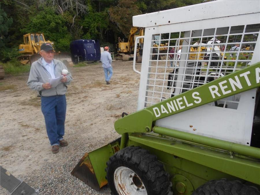 Elmer Barger of Raynham, Mass,. examines a classic excavator.
