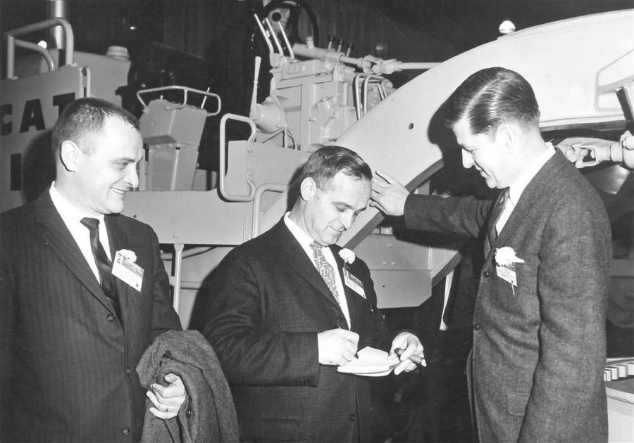 Jack Milton (L) and Bill Jordan (R) met with Tom Palazzi of Palazzi Corporation at the 1963 Construction Equipment Exposition in Chicago. Palazzi Corporation built much of I-89, I-93 and I-91 in northern New England.