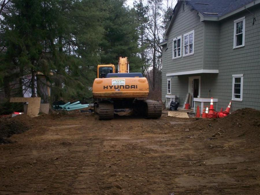 Crews grade the front of property job site.