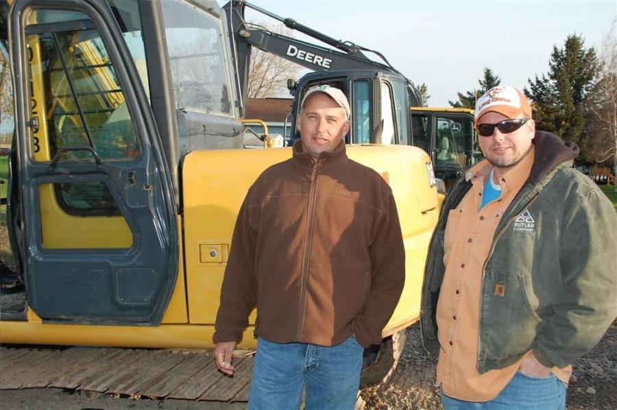 Giving this John Deere backhoe a close inspection are Herb (L) and Bill Boyze of Herb Boyze Grading Company, Fairport, N.Y.