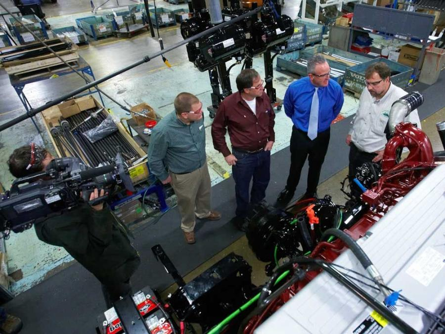 "A cameraman from the Discovery Channel's show ""American Loggers"" shoots as officials from Mack Trucks Inc. and customer Gerald Pelletier Inc. tour the Mack Macungie Assembly Operations outside Allentown, Pa. (L-R) are Jeff Pelletier, Mac"