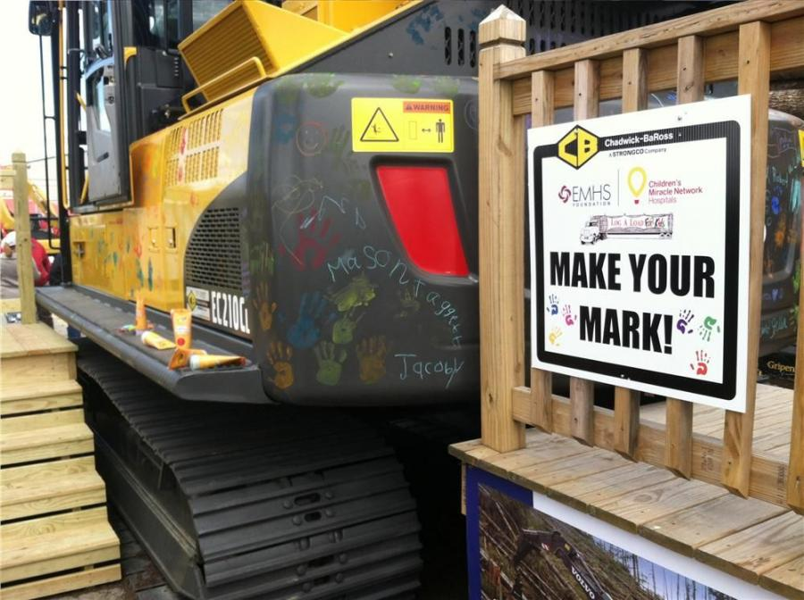 "At the Chadwick-BaRoss ""Make Your Mark"" Event, children were encouraged to paint, draw and place handprints on a Volvo EC210 CL."