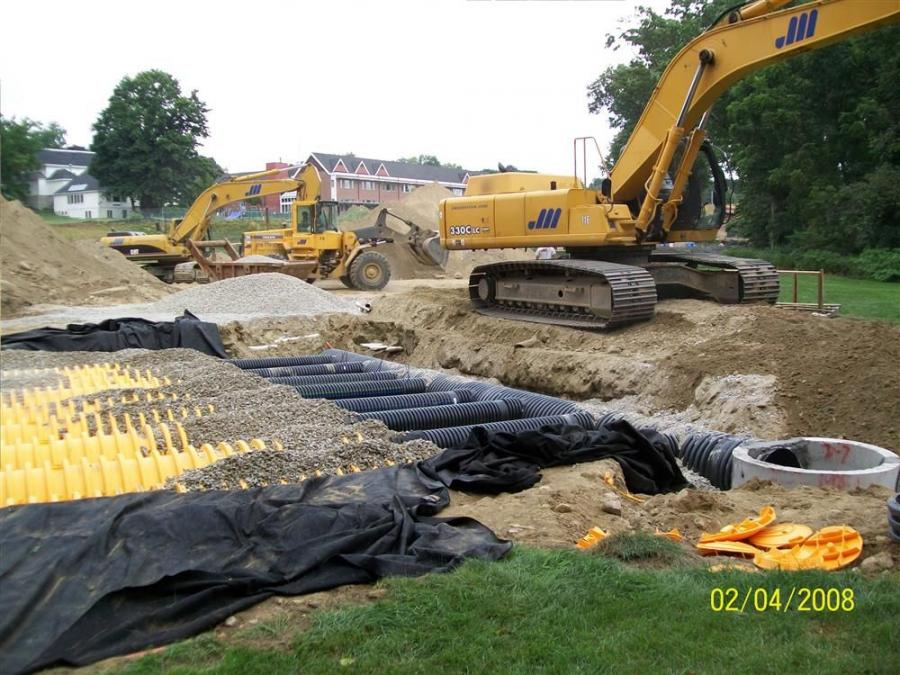 Masterson installs Stormtech underground drainage system with a John Deere 330 excavator and a Volvo L90 loader.