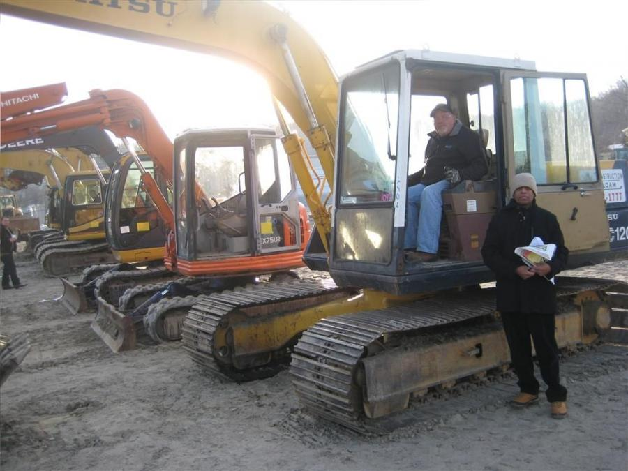 Jeff Leone, owner of Air Temp of Southington, Conn., is trying the Komatsu excavator on for size, and Ban Dissanayake of Sri Lanka. Dissanayake is looking at shipping heavy iron overseas to help a construction boom in his country now that war has ended.