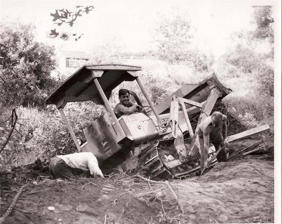 Anthony Spazzarini and his John Deere iron being given a helping hand after getting stuck in a ditch, circa 1970.