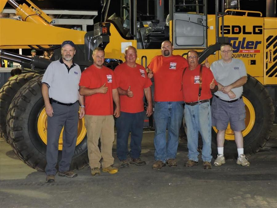 The team at Tyler Equipment celebrates the company's addition of SDLG wheel loaders to its product offerings.