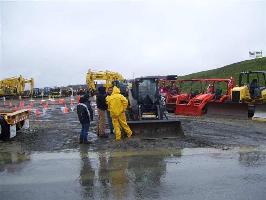 Guests at Westchester Tractor braved the rain and mud in order to check out the company's equipment fleet.
