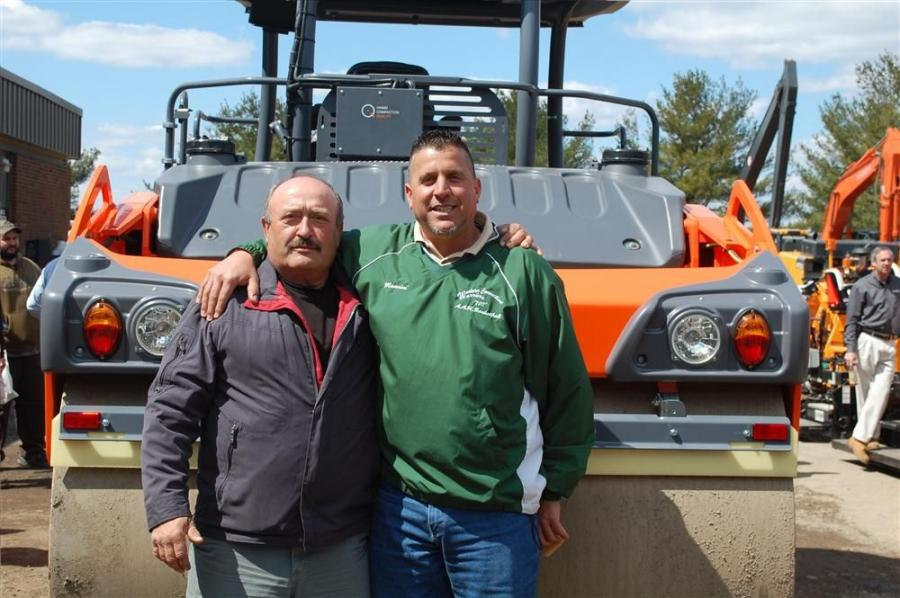 Carmen Gugliotti (L), paving superintendent and Victor Mancini, paving foreman, both of O & G Industries, are ready to check out new paving equipment.