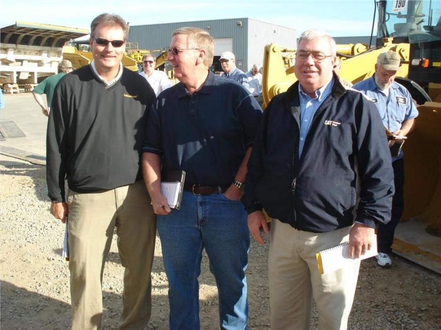 (L-R): John Hood, Carolina CAT, Charlotte, N.C.;  Billy Seals, Thompson Tractor Company, Birmingham, Ala.; and Wayne Calton, Gregory Poole Equipment Company, Raleigh, N.C.; talk sports before the auction begins.