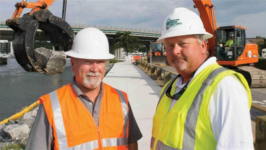 Tom Grant (L), salesman of H&E Equipment and Chris Coleman, owner of Carolina Marine Structures discuss the project.